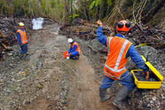 Seismic reflective survey. Men setting off explosive charges in a seismic reflective survey looking for oil on the West Coast of New Zealand Royalty Free Stock Images