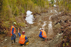 Seismic reflective survey. Men setting off explosive charges in a seismic reflective survey on the West Coast of New Zealand. The 4WD in the background carries Royalty Free Stock Photography