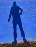 Men shadow on blue ceramic tiles Stock Images