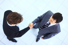 Men shaking hands. Two successful business men shaking hands Royalty Free Stock Images