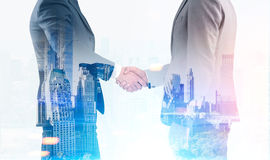 Men shaking hands, blue Stock Image
