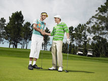 Men Shaking Hands At Golf Course Royalty Free Stock Photo