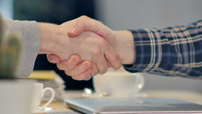 Men shaking hands at the meeting. Close up. Professional shot in 4K resolution. 090. You can use it e.g. in your commercial video, business, presentation stock footage