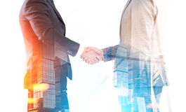 Men shaking hands in morning Royalty Free Stock Photo