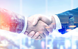 Men shaking hands, office, night city Stock Photography