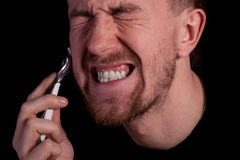 Men shaving faces. Close-up. Royalty Free Stock Photos
