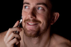 Men shaving faces. Close-up. Royalty Free Stock Photography