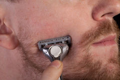 Men shaving faces. Close-up. Stock Photography