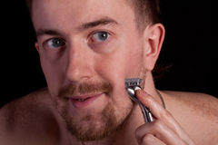 Men shaving faces. Close-up. Royalty Free Stock Image