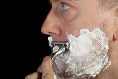 Men shaving faces. Close-up. Stock Image