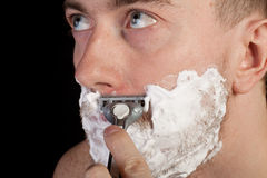 Men shaving faces. Close-up. Royalty Free Stock Photo