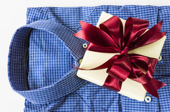 Men shirt. Business men's shirt and gift box , isolated on white background Stock Photos