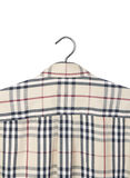 Men shirt on a hanger. Abstract background Stock Photography