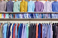 Men shirts in clothing store Stock Images