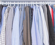 Men shirts hang on a clothes hanger Royalty Free Stock Images