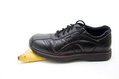 Men shoe steps on banana Royalty Free Stock Photography