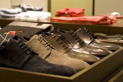 Men shoes. Various kind of casual men shoes on shelf in store Stock Photography