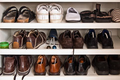 Men shoes in a closet. Men shoes on shelves in a closet stock image