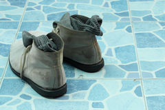 Men shoes on tiled floor Royalty Free Stock Photo