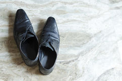 Men shoes top view. On textured background Stock Photo