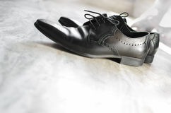 Men shoes top view. On textured background Stock Photos