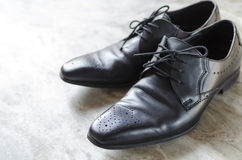 Men shoes top view. On textured background Royalty Free Stock Photo