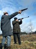 Shooting men Stock Image