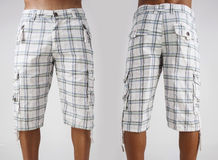 Men in shorts Royalty Free Stock Photography