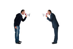 Men shouting through megaphones isolated. Men shouting with megaphones isolated on white background Royalty Free Stock Photography