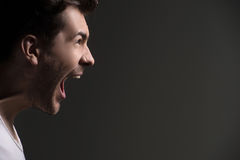 Men shouting. Side view of men shouting while  on grey Stock Photo