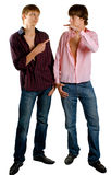 Men show by finger to each other Stock Photography