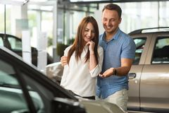 Men shows new car for his girl. stock photo