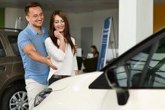 Men shows new car for his girl stock photos