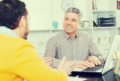 Men sign credit agreement Royalty Free Stock Images