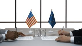Men signing papers at desk. Handshake on white background. Agreement between politicians. America cooperates with EU stock video