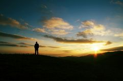 Men silhouette on sunset. Men silhouette on the sunset background Stock Photo