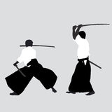 Men silhouettes practicing Aikido Royalty Free Stock Photo