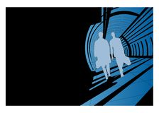 Men silhouettes walking. Composition, silhouettes of business men traveling on a blue corridor, black wall on the left Royalty Free Stock Photography