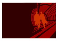Men silhouettes walking. Composition, silhouettes of business men traveling on a red corridor, dark wall on the left Royalty Free Stock Photos