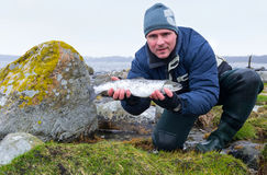 Men with silver seatrout Royalty Free Stock Photography