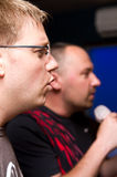 Men singing karaoke. Two men singing karaoke together Stock Photos