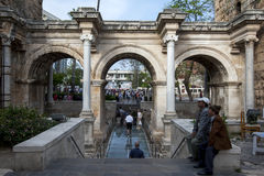 Men sit at the stairs which lead through The Gate of Hadrian at Antalya in Turkey. Stock Photography
