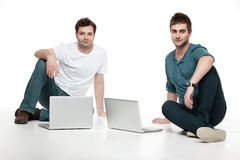 Men sitting in front of laptops Stock Photos