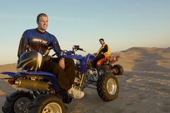 Men Sitting On Quadbikes In Desert Stock Photos