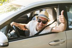 Men sitting in a rental car on holiday vacancy. A man sitting in a rental car on holiday vacancy royalty free stock image
