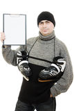 Men with skates with a blank sheet of paper Stock Photo
