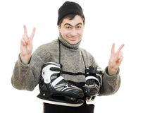 Men with skates gesture shows okay Royalty Free Stock Photos