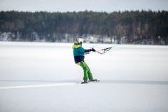 Men ski kiting on a frozen lake Stock Image