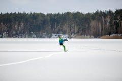 Men ski kiting on a frozen lake Stock Images