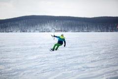 Men ski kiting on a frozen lake Royalty Free Stock Image